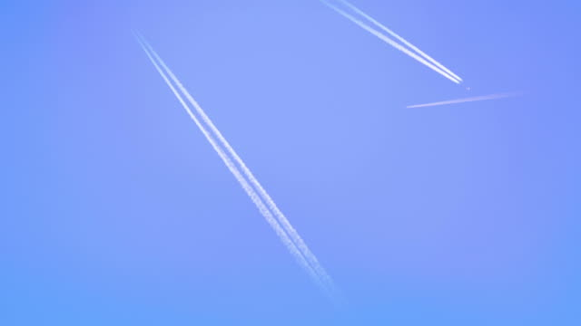 Airplanes with trails flying over screen