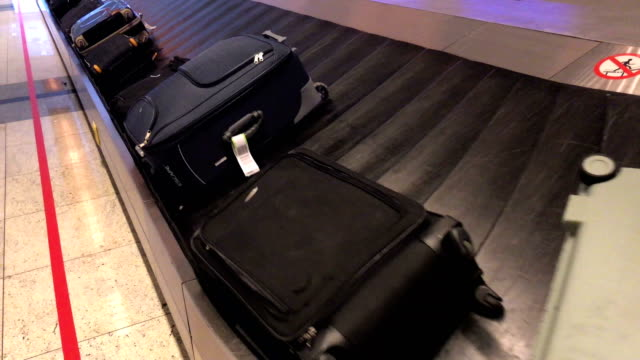 airport baggage claim - carry on luggage stock videos and b-roll footage
