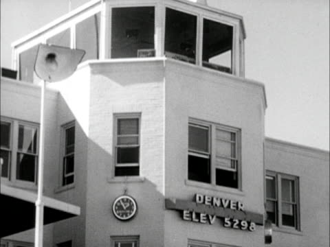 airport building & control tower, sign 'elev 5298.' passengers exiting united dc-6 commercial flight aircraft, walking down stairs to tarmac. - stapleton stock videos & royalty-free footage