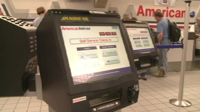 airport check in machines on december 20 2011 in dallas texas - aeroplane ticket stock videos & royalty-free footage