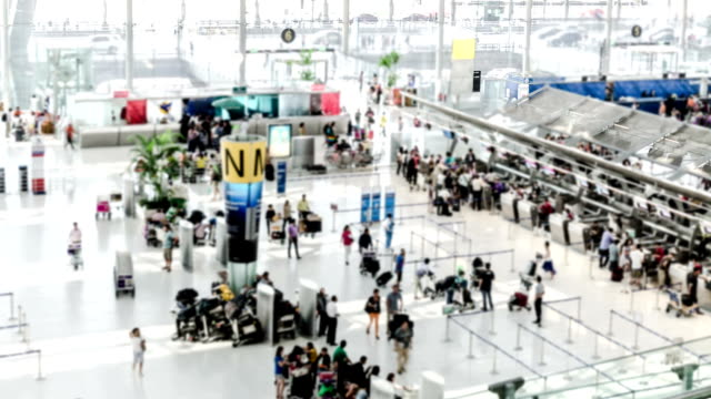 airport check-in area time-lapse - airport stock videos and b-roll footage