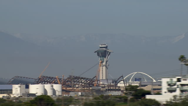 airport control tower at the los angeles international airport, california. - tower stock videos & royalty-free footage