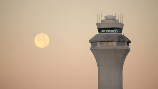 HD airport control tower with moon