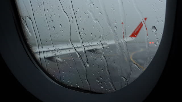 4k airport delay due to rain storm bad weather - aircraft wing stock videos & royalty-free footage