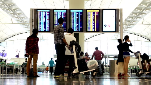 airport departure and arrival board - hong kong international airport stock videos and b-roll footage
