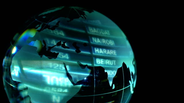 airport departure board projected on glass earth globe - baghdad stock videos & royalty-free footage