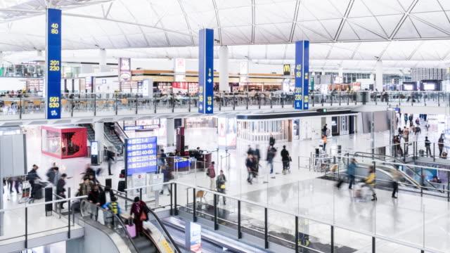 t/l ws pan airport departure lounge / hong kong, china - hong kong international airport stock videos and b-roll footage