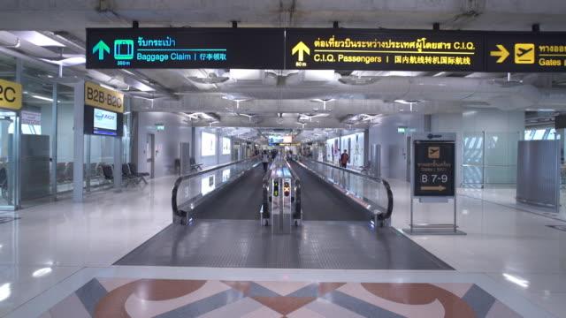 airport escalator - hong kong international airport stock videos and b-roll footage
