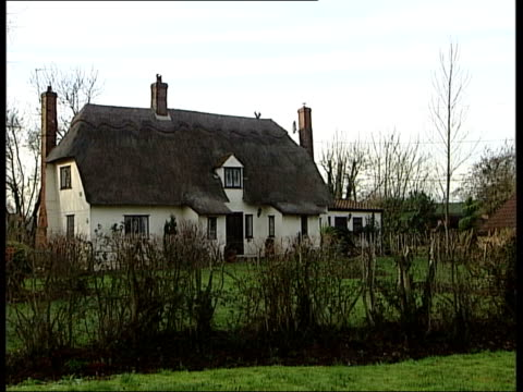 airport expansion plans announced itn brockstead ryanair plane along overhead as landing at stansted airport pull out to reveal thatched cottage sign... - strohdach stock-videos und b-roll-filmmaterial