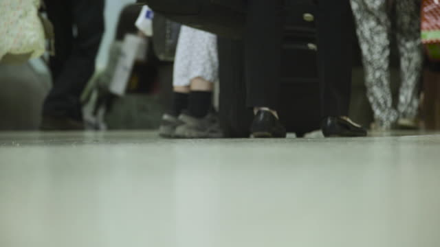 Airport feet and luggage - Los Angeles