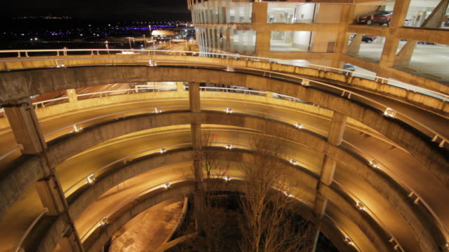 Airport hangar environment in fast motion w/ parking garage