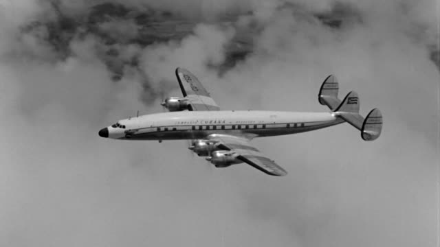airport in cuba people getting into the cuban airlines airplane aerial shots of cuban plane dramatization - cuban culture stock videos & royalty-free footage