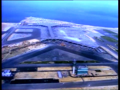 airport itn day air view new airport built on island recalimed from the south china sea int people around new terminal building - south china sea stock videos & royalty-free footage