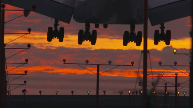 Airport Landing with Dramatic Sunset Sky