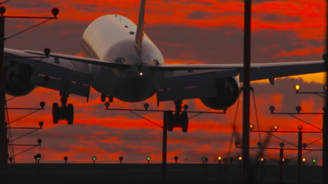 Airport Landing with Richly Painted Sunset Sky