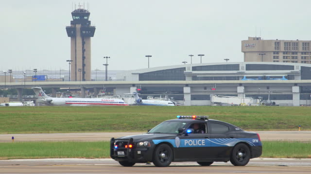 Airport police vehicle parked on runway