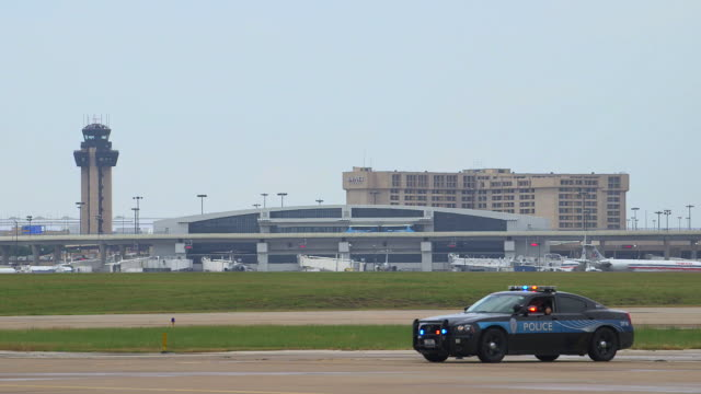 pan airport police vehicle to airline passenger plane taking off/dfw international airport, dallas-fort worth, texas, usa - dallas fort worth airport stock videos & royalty-free footage
