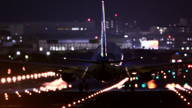 airport runway at night - landing touching down stock videos & royalty-free footage