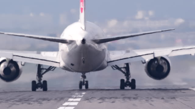 airport runway with airplane - air vehicle stock videos & royalty-free footage