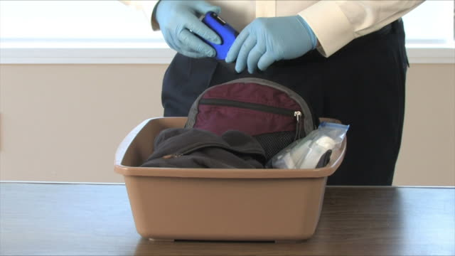 airport security finds knife in carryon - bag stock videos & royalty-free footage
