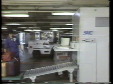 airport security; saic f/back luggage through thermal neutron analysis machine - neutron stock-videos und b-roll-filmmaterial