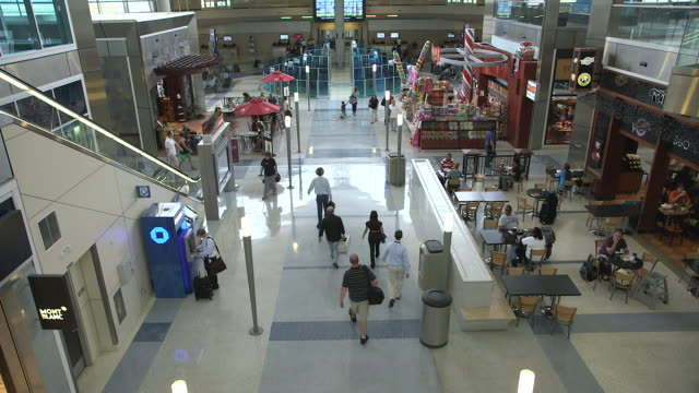 ha of airport terminal interior with passengers walking to departure gates/dfw international airport, dallas-fort worth, texas, usa - dallas fort worth airport stock videos & royalty-free footage