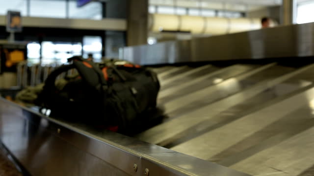 airport terminal luggage transportation - perpetual motion stock videos & royalty-free footage