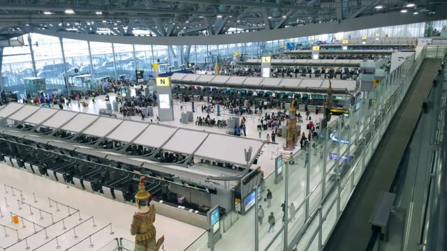 airport terminal with crowd passenger travelling. - airline check in attendant stock videos and b-roll footage