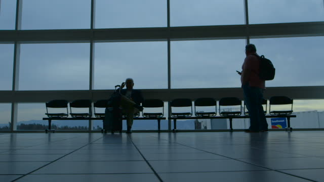 airport travel silhouette - rucksack stock videos and b-roll footage