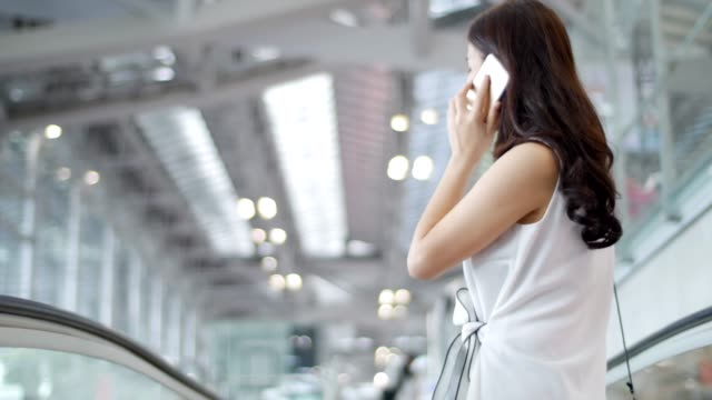 Airport traveler talking on the phone