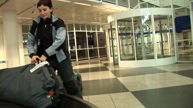hd: airport - picking up stock videos & royalty-free footage