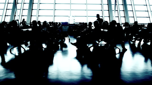 airport with passenger silhouettes - gate stock videos & royalty-free footage