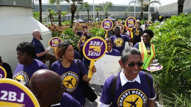 airport workers protest at miami international airport as they call for fair wages union rights paid sick leave and safe workplaces on october 2 2018... - trade union stock videos & royalty-free footage