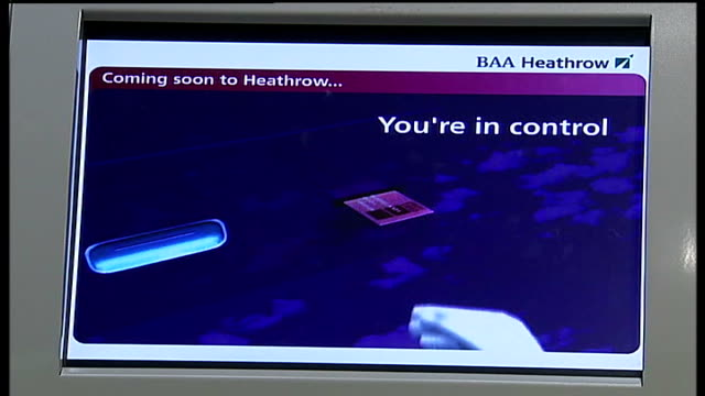 biometric scanning trial at heathrow airport computer screen showing baa heathrow biometric scanning system instructions finger placed on scanning... - instructions stock videos & royalty-free footage