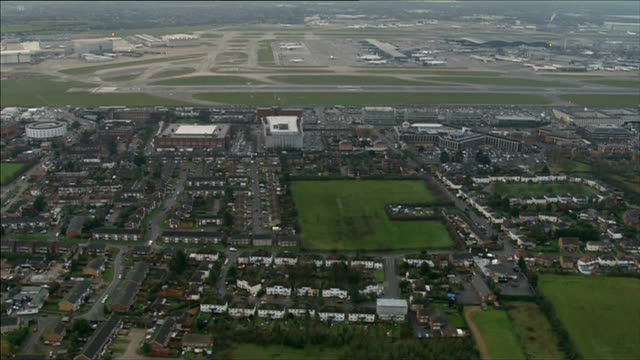 airports commission suggests heathrow or gatwick for a new runway: air views of heathrow and stansted airports; england: london: ext air views /... - surrounding stock videos & royalty-free footage