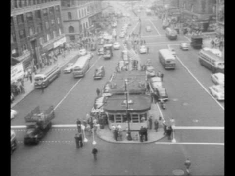 airraid siren with vo it starts to blare as airraid drill in new york city begins / deserted times square with a couple of civil defense workers in... - air raid siren stock videos & royalty-free footage