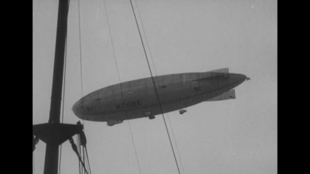 vs airship norge bearing roald amundsen's expedition to cross the north pole flies above spitsbergen norway where richard e byrd's arctic expedition... - airship stock videos & royalty-free footage