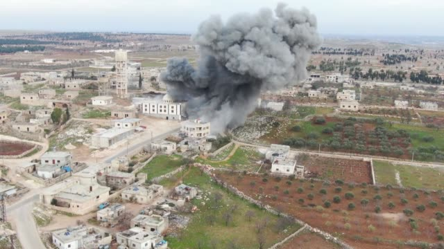 stockvideo's en b-roll-footage met airstrikes by the bashar al-assad regime hit northwestern idlib province of syria on january 16, 2020. more and more civilians are losing their lives... - luchtaanval