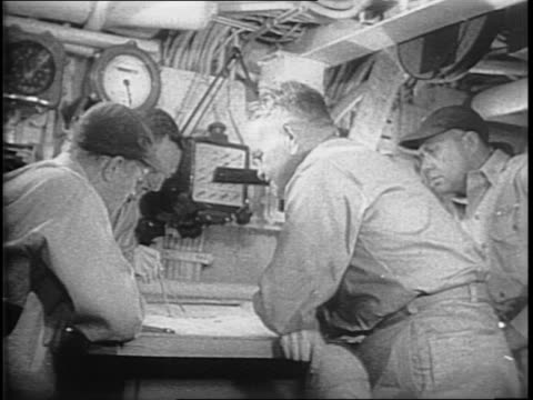 stockvideo's en b-roll-footage met airstrikes hitting land below / view from a cockpit of ships at sea / admiral william halsey in a ship's chart room with a group of officers / side... - tweede wereldoorlog in azië