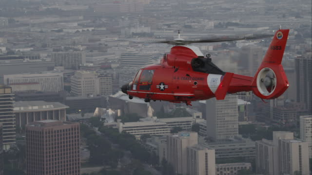 air-to-air coast guard helicopter in city - coast guard stock videos and b-roll footage