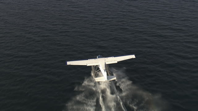 Air-to-air of a sea plane taking off.