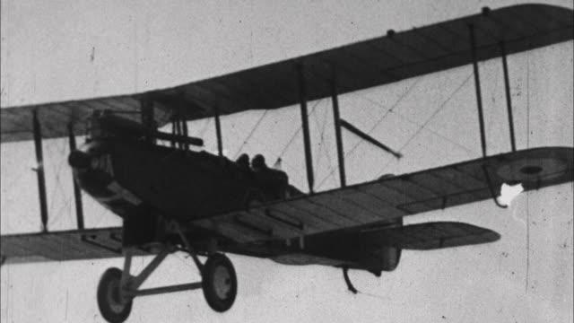 stockvideo's en b-roll-footage met airtoair shot of biplane / france - 1917
