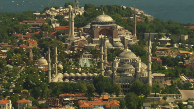 air-to-air pan with flock of white storks flying over hagia sofia and suleymaniye mosques in istanbul - suleymaniye mosque stock videos and b-roll footage