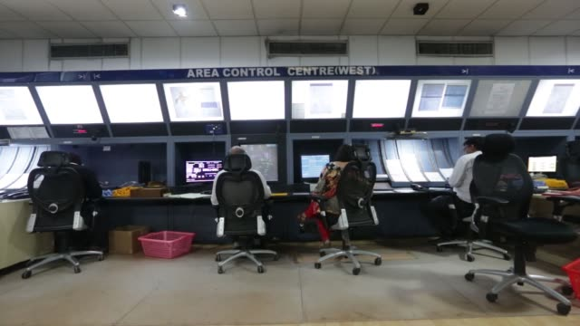 Airtraffic control equipment and monitors sit inside a control tower at Indira Gandhi International Airport in Delhi India on Monday July 18...