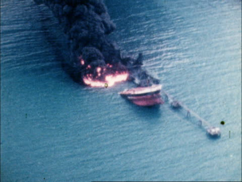 airv burning ship zoom in ) tx 8.1.79. airv ditto ) col pos: pull back loading jetty hut on loading jetty side of hut - burning stock videos & royalty-free footage