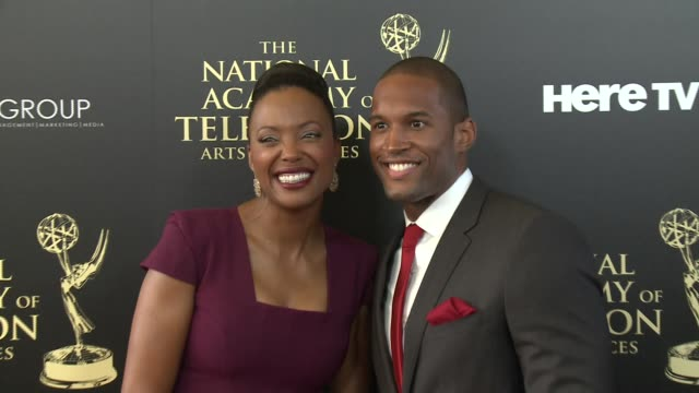 Aisha Tyler and Lawrence SaintVictor at the 2014 Daytime Emmy Awards at The Beverly Hilton Hotel on June 22 2014 in Beverly Hills California