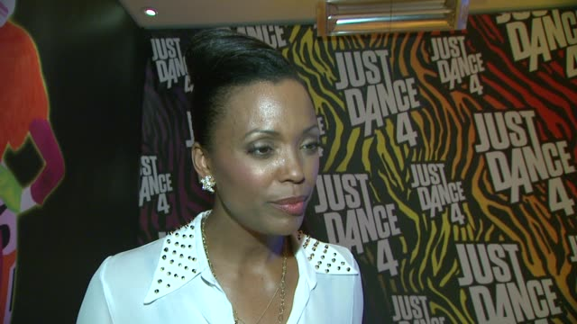 Aisha Tyler on what she thought of the game Just Dance 4 how she liked the music in the game on being a part of the Entertainment Weekly party her...