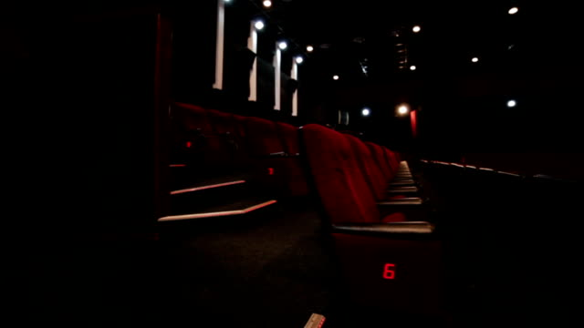 Aisle in red cinema hall