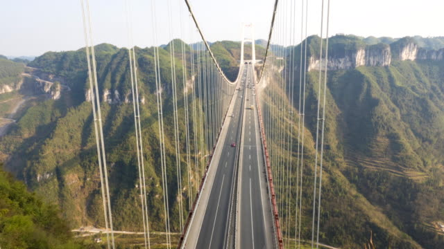 aizhai bridge aerial view - suspension bridge stock videos & royalty-free footage