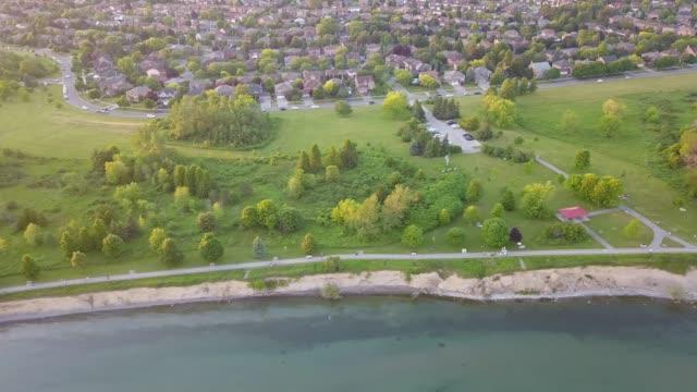 ajax by drone beside lake ontario - waterfront stock videos & royalty-free footage